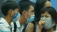 Passengers wear masks at the Ho Chi Minh City's Tan Son Nhat International Airport in August, 2009.