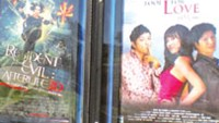 A poster of Vietnam's 2010 romantic-comedy De Mai tinh (Fool for love), starring Dustin Nguyen and Kathy Uyen, at the Regal Ballston Commons 12 in Washington, D.C.