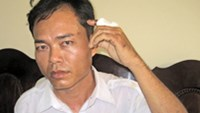 Do Quoc Thai, a driver for the Mai Linh Taxi Company, says that a drunk, off-duty police Major assaulted him with his belt after he refused to run a red light