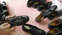 A man makes shoes in the handicraft village of Gie Ha. The village, with a tradition for leather shoe making that stretches back nearly 100 years, produces about 100,000 pairs of hand-made shoes a yea