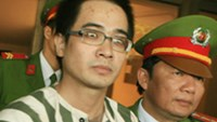 Nguyen Duc Nghia (C), who was sentenced to death last year for beheading and robbing his ex-girlfriend, is awaiting execution.