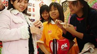 Visitors in a condom booth at an event on the theme of HIV/AIDS fight in Hanoi.