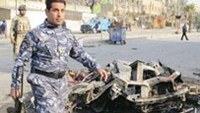 Iraqi security forces inspect the site of the bomb attack in Baghdad's Shaab District, northern Baghdad, December 22, 2011.