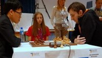 Vietnam's No.1 chess player Le Quang Liem (L) on Monday beat the world No.4 Russian to enter the fourth round of the World Cup 2013 in Tromso, Norway. Photo by chessworldcup