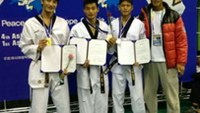 (from left) Nguyễn Văn Sơn, Đinh Quang Đức, Nguyễn Quang Huy and Coach Nguyễn Văn Hùng of the male team. Photo by Xuan Thanh