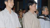 Tran Kim Long (1st,R) was sentenced to 25 years in jail for bribery and abuse of powerat a trial in 2007
