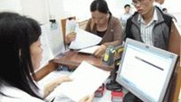 People wait to register tax codes at the Ho Chi Minh City Taxation Department.