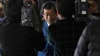 Tokyo Electric Power Co President Masataka Shimizu is mobbed by the media upon his arrival for a meeting with Japan's Vice Trade Minister Motohisa Ikeda at the Nuclear Disaster Countermeasures Offic