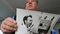 Volodymyr Palkin, 69, a former employee of the Chernobyl Nuclear Power Plant and now a patient in Kiev's radiological hospital displaying his picture taken at the plant some 25 years before.