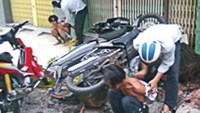 Crime-branch police officers arrest two robbers on a street in Ho Chi Minh City