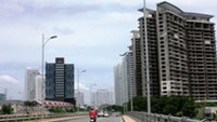 The government should develop a series of cheap residential projects to bring down home prices, experts say