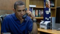 US President Barack Obama holds a conference call from Camp David, Maryland, in this August 6, 2011 photo release.