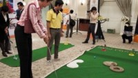 Guests play games at New Focus' 5th birthday party in Ho Chi Minh City on July 27.