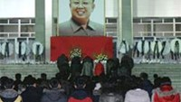 North Koreans make a call of condolence for deceased leader Kim Jong-il in Pyongyang in this picture released by the North's official KCNA news agency early December 21, 2011.