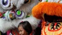 A child poses for a photo in Manila's Chinatown on February 2, 2011.