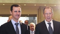 Syria's President Bashar al-Assad (L) welcomes Russian Foreign Minister Sergei Lavrov in Damascus, February 7, 2012.