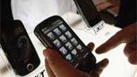 A member of the media browses through the Acer M900 smartphone.