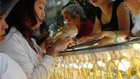 Customers buy gold at a jewelry shop in Ho Chi Minh City.