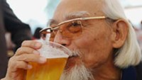 Drinkers attend the 'Hanoi Beer Festival' held in downtown Hanoi on December 4, 2011