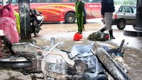 A burnt motorbike at a gas station in Thua Thien-Hue Province on January 13