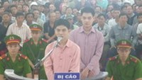 2 get death for killing, dismembering gay partner in southern Vietnam