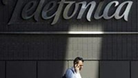 A man talks on his cell phone outside Telefonica headquarters in Madrid.