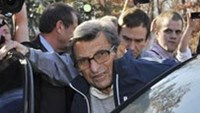 Penn State Football coach Joe Paterno enters a car after leaving his home to attend practice in State College, Pennsylvania, November 8, 2011.