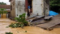 Children in a house in an isolated area of Quang Binh Province as typhoon Ketsana stormed central Vietnam in 2009.