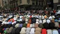 Men pray on the street before the start of the American Muslim Day Parade in New York.