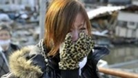 A woman cries after learning that her mother was successfully rescued from a building following an earthquake and tsunami in Miyagi Prefecture, northeastern Japan March 12, 2011