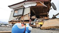 A toy lies in front of a destroyed house in the devastated city of Ofunato. Rescue teams from the US, Britain and China began assisting in the search for survivors following the devasting earthquake a