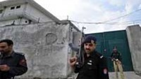 Pakistani policemen stand guard outside the hideout of slain Al-Qaeda leader Osama bin Laden in Abbottabad on May 5.