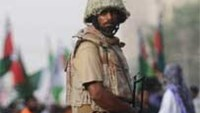A Pakistan paramilitary soldier stands guard during a protest over the slaying of Al-Qaeda chief Osama bin Laden in Karachi.