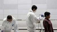 Officials scan people for radiation, 60 km west of the nuclear power plant in Fukushima prefecture, in Koriyama in March.