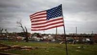 An American flag is is seen in front of a destroyed church in Joplin, Missouri May 26, 2011.