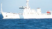 One of three Chinese patrol ships that illegally entered Vietnam's territorial waters and disrupted a seismic survey being conducted by PetroVietnam on Friday