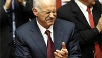 Greek Prime Minister George Papandreou applauds after winning a vote of confidence in the Greek parliament in Athens November 5, 2011.