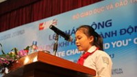 "A student at Hanoi's Phan Chu Trinh Secondary School speaks at the launch of the ""Climate Change and You"" contest Monday"