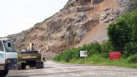 Trucks approach a mountain in the Mekong Delta province of Kien Giang