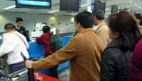 Vietnamese passengers wait at Chengdu airport before flying to Ho Chi Minh City