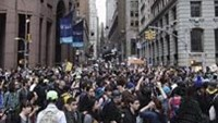 Members of the Occupy Wall Street movement march down Wall Street during a protest in New York October 14, 2011.