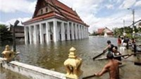 Villagers built a wooden bridge in a flooded temple complex in Nonthaburi province, on the outskirts of Bangkok October 16, 2011.