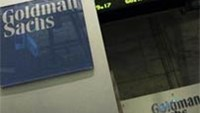 A Goldman Sachs sign is seen over their kiosk on the floor of the New York Stock Exchange, April 26, 2010.