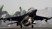 A US-made F-16 figther lands during a drill near Tainan city in April 2011.