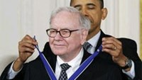 Investor and philanthropist Warren Buffet receives the Medal of Freedom from President Obama at the White House in Washington, February 15, 2011.
