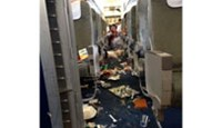 A photo shows food and other loose items scattered on the floor of Vietnam Airlines' Airbus 321 after it encountered severe turbulence Tuesday