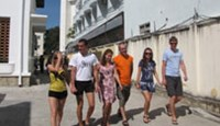 Russian tourists walk on a street of the central Vietnam resort town of Nha Trang.