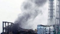 Black smoke rises from reactor number three at the Fukushima nuclear power plant in March 21, 2011.
