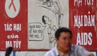 A file photo shows billboards in Hanoi warning people that drugs and having sex with prostitutes lead to AIDS. Photo: AFP