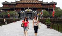 Tourists at the royal citadel in Hue.